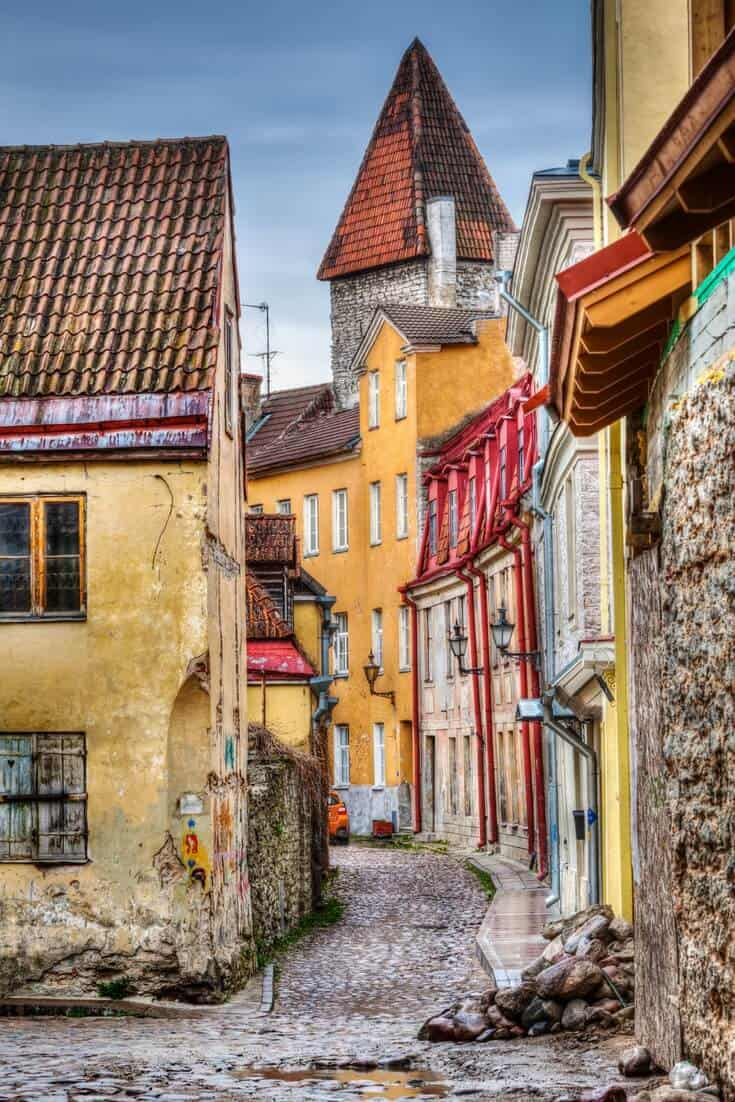 Tallinn Old Town with its colourful buildings, stone towers, cobblestone streets.