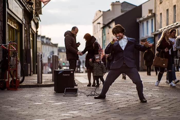 Lively Quay street for shops and live music in Galway city, Irleand
